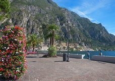 Lakeside promenade limone with flower column and lake view. Garda lake italy royalty free stock images