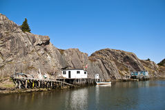 Lakeside Property. Fishing Docks and Moored Boats against a Cliff Face Royalty Free Stock Photography