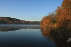 Lakeside Reflection. A lovely morning autumn reflection of the hillside can be seen in Cross Creek Lake, Washington County, Western Pennsylvania Stock Photography