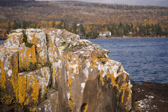 Lakeside rock formation. A view of a rock formation on the side of a lake at Artist Point, Grand Marais, Minnesota (USA), on an autumn day Stock Photography