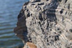 Lakeside rocks Stock Images