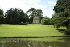 Lakeside scene in Buckingham, England. Temple of Ancient Virtue at a lakeside in Stowe Landscape Gardens, Buckingham, England Stock Photography