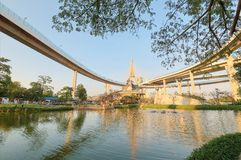 Lakeside scenery under Bhumibol Bridge or Industrial Ring Road  with view of elevated highway interchange & bridge tower Royalty Free Stock Image