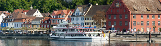 Lakeside of the town of Meersburg. Panoramic view of the town of Meersburg from the lakeside with an excursion ship on the promenade, Germany Stock Image