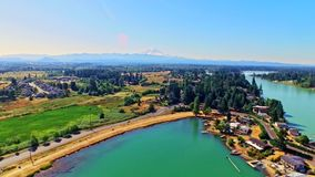 Lakeside town waterfront with Mt Rainier in background stock video