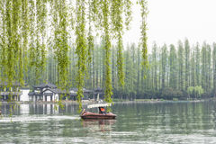 lakeside trees and boat royalty free stock photography