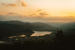 Lakeside valley at sunset Stock Images