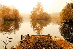 Autumn lakeside view. Autumnal scene of islands in lake from a small jetty Royalty Free Stock Photography