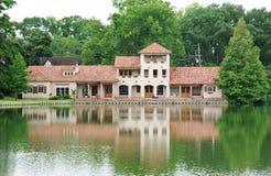 Lakeside Villa. Villa style home on the edge of a pond/lake Stock Photos