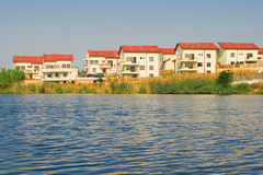 Lakeside villas. Modern villas by the lake royalty free stock photos