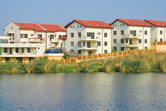 Lakeside villas. Modern villas by the lake royalty free stock image