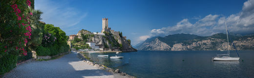 Lakeside walkway malcesine with view to scaligero castle Royalty Free Stock Images