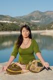 Lakeside yoga Stock Photo
