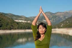 Lakeside yoga Stock Images