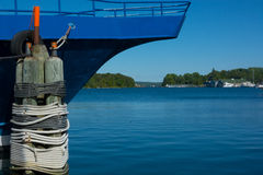 Lakeview from dock framed with bow of boat. View from the dock at Lake Charlevoix, Michigan, with bright blue of a bow of a boat and nearly matching blue of the Royalty Free Stock Photography