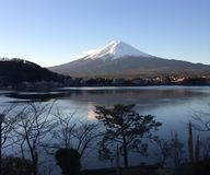 Lakeview of Mount Fuji with snow on top. A view across lake to Mount Fuji royalty free stock photography