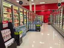 Target, Black Friday on Thanksgiving 2017. LAKEWOOD, CO: Television sets juxtapose grocery aisles at Target on Thanksgiving evening during Black Friday sales Royalty Free Stock Photography