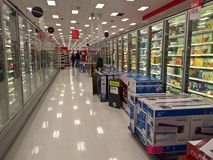 Target, Black Friday on Thanksgiving 2017. LAKEWOOD, CO: Television sets juxtapose grocery aisles at Target on Thanksgiving evening during Black Friday sales Royalty Free Stock Photo