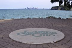 Lakewood ohio sign by the lake. The city of cleveland can be seen from the other side of the lake stock photos