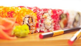 Laki sushi rolls at woody plate Stock Photos