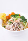 Laksa noodle soup with chicken, fresh vegetables and wonton on t Stock Images