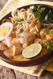 Laksa soup with chicken, egg, rice noodles, bean sprouts and cor Royalty Free Stock Photo