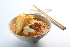 Laksa Spicy Noodle. Malaysia favorite spicy noodle laksa with fish cake and cockle stock photo