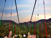 Lakshman Jhula. Is an iron suspension bridge situated in Tapovan in the boundary of New Tehri district of the Indian state of Uttarakhand. It was erected over stock images