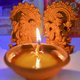 Lakshmi Ganesha pooja. Festival of diwali celebrated with oil lamps and worship of idols of lakshmi ganesha - hindu goddess of wealth and god of prosperity Royalty Free Stock Photo