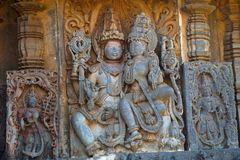 Lakshmi sitting in the lap of Vishnu. Hoysalesvara Temple, Halebid, Karnataka. 12th Century. Shiva temple. Reliefs on the outer wall of the Hoysaleswara Temple Stock Photography