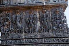 Lakshmi sitting in Vishnu`s lap and other deities. Hoysalesvara Temple. Halebid, Karnataka, 12th Century. Shiva temple Royalty Free Stock Image