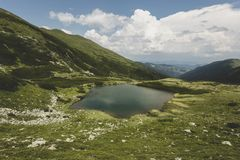 Lala Mare glacial lake. In the glacial valley carved at the base of Ineu Royalty Free Stock Photos