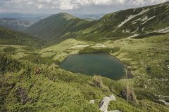 Lala Mare glacial lake. In the glacial valley carved at the base of Ineu royalty free stock images