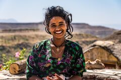 Free Lalibela, Ethiopia - Feb 13, 2020: Young Woman In Traditional Clothing Is Preparing A Coffee Ceremony Stock Photography - 198050462