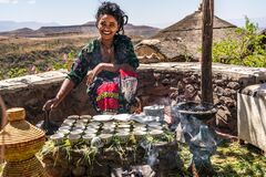 Free Lalibela, Ethiopia - Feb 13, 2020: Young Woman In Traditional Clothing Is Preparing A Coffee Ceremony Royalty Free Stock Photography - 204261037