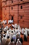Lalibela, Ethiopia, 14th June 2009: Group of pilgrims standing outside of rock hewn church stock photo