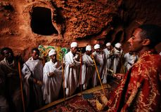 Lalibela, Ethiopia: Group of priests chanting prayers. Lalibela, Ethiopia, 14th June 2009: Group of priests chanting prayers inside rock hewn church royalty free stock images