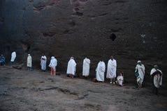 Lalibela, Wollo, Ethiopia, circa February 2007: Pilgrims attending religious service. Outside of rock hewn church stock photography