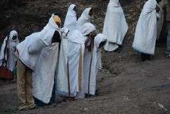 Lalibela, Wollo, Ethiopia, circa February 2007: Pilgrims attending religious service. Outside of rock hewn church stock photo