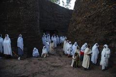 Lalibela, Wollo, Ethiopia: Pilgrims attending religious service. Outside of rock hewn church stock images