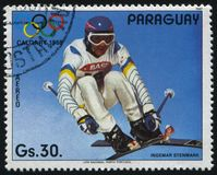 Lalom and giant slalom at Winter Olympics at Calgary. RUSSIA KALININGRAD, 19 APRIL 2017: stamp printed by Paraguay, shows Ingemar Stenmark, slalom and giant Royalty Free Stock Photos