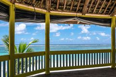 Lalomanu Beach, Upolu Island, Samoa - October 27, 2017: View fro. M inside a traditional waterfront beach fale hut onto the blue Pacific Ocean stock photo