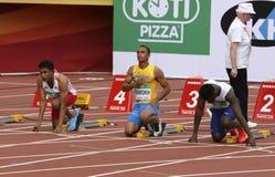 LALU MUHAMMAD ZOHRI Indonesia, VASYL MAKUKH Ucrania, RIKKOI BRATHWAITE IVB en 100 m Semi-final en el campeón del mundo U20 de IAA imagenes de archivo