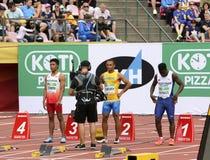 LALU MUHAMMAD ZOHRI Indonesia, VASYL MAKUKH Ucrania, RIKKOI BRATHWAITE IVB en 100 m Semi-final en el campeón del mundo U20 de IAA fotos de archivo libres de regalías