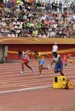 LALU MUHAMMAD ZOHRI Indonesia, VASYL MAKUKH Ucrania, RIKKOI BRATHWAITE IVB en 100 m Semi-final encendido fotografía de archivo libre de regalías