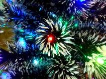 Lamé del nuovo anno con le luci al neon su un primo piano dell'albero di Natale Fotografia Stock Libera da Diritti