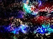Lamé del nuovo anno con le luci al neon su un primo piano dell'albero di Natale Immagini Stock Libere da Diritti