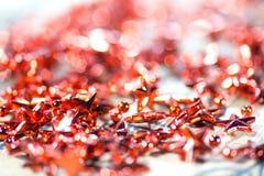 Lamé rosso delle stelle per l'albero di Natale Immagine Stock Libera da Diritti
