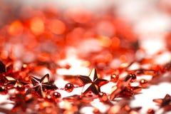 Lamé rosso delle stelle per l'albero di Natale Fotografia Stock Libera da Diritti