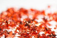 Lamé rosso delle stelle per l'albero di Natale Fotografie Stock